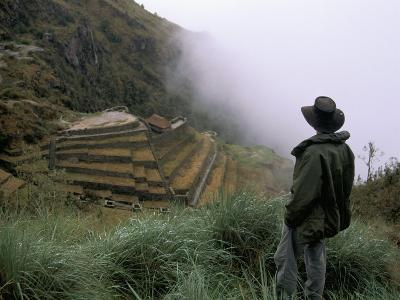 Tourist Watches Clouds Swirl Around Mountains, Inca Trail, Peru, South America