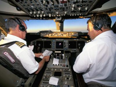 Pilots on Flight Deck of Jumbo Boeing 747 of Air New Zealand with Sunrise Ahead