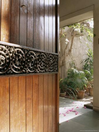A Modern Front Door Decorated with a 400 Year Old Piece of Wood Carving