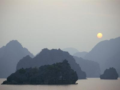 Sunset Against Limestone Grotto Islands, Halong Bay, Vietnam, Indochina, Southeast Asia