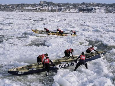 Ice Canoe Races on the St. Lawrence River During Winter Carnival, Quebec, Canada