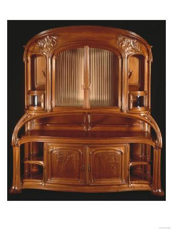 A Highly Important Carved Mahogany Sideboard