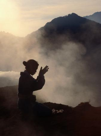Woman Leaving an Offering on Mt. Batur, Batur, Bali, Indonesia