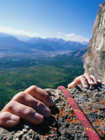 Climbers Hands Holding Onto Rock Ledge, Alberta, Canada