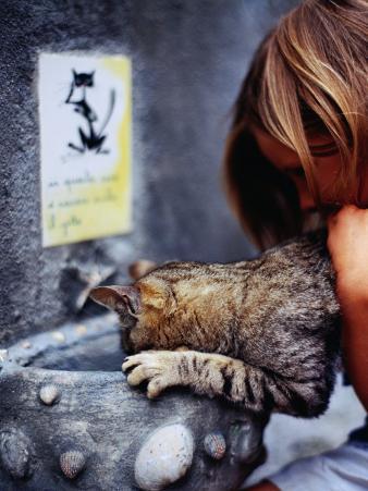 Girl Helping Cat at Cat Fountain, Positano, Campania, Italy