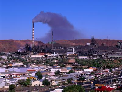 Smoke Billowing from a Smelter Stack with Mt. Isa in the Foreground, Australia