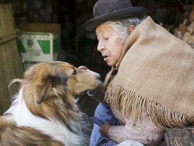 Elderly Female Vendor at Mercado de Los Brujas with Her Dog, La Paz, Bolivia