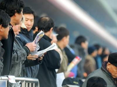 People Studying Form Guide at Seoul Racecourse, Seoul, South Korea