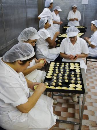 Kitchen Workers Making Portuguese Tarts at Antiga Confeitaria de Belem, Lisbon, Portugal