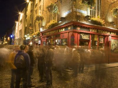 People Walking Past the Temple Bar at Night, Dublin