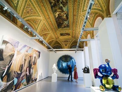Visitors Viewing Modern Art in the Historic Palazzo Grassi, Venice, Italy