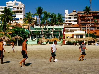 Locals Playing Soccer on la Madera Beach, Zihuatanejo, Guerrero, Mexico