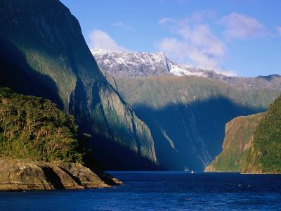 Boat in Distance Between Mountains, Milford Sound, New Zealand