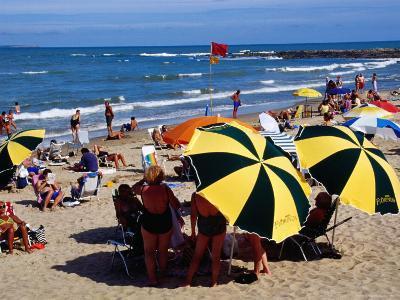 Beach Umbrellas and People on Playa el Emir in Summer, Punta del Este, Maldonado, Uruguay