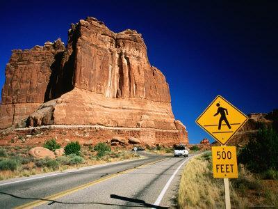 Road Sign in Front of Courthouse Towers, Arches National Park, Utah