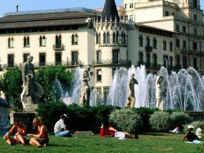 People Relaxing in Plaza de Catalunya, Barcelona, Catalonia, Spain