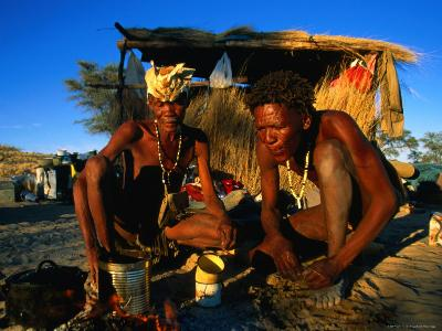 Kalahri Bushmen Cooking on Fire Outside Their Grass Homestead, South Africa