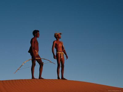 Kalahari Bushmen Standing on Sand Hill, South Africa