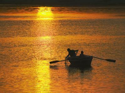 Rowing Boat on Ganges River at Sunset, Varanasi, India