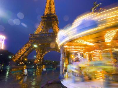 Eiffel Tower in Twilight Fog and Rain, Merry-Go-Round in Foreground, Paris, France