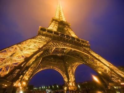 Base of Eiffel Tower at Night, Paris, France