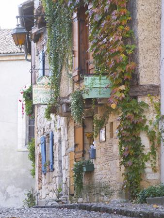 Cobblestone Street with Half Timber Stone Houses, Place De La Myrpe, Bergerac, Dordogne, France