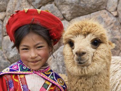 Girl in Native Dress with Baby Alpaca, Sacsayhuaman Inca Ruins, Cusco, Peru