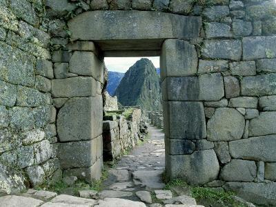 View Through Stone Doorway of the Inca Ruins of Machu Picchu in the Andes Mountains, Peru