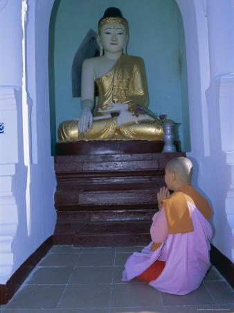 Nun and Statue of the Buddha, Shwedagon Paya (Shwe Dagon Pagoda), Yangon (Rangoon), Myanmar (Burma)