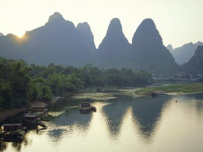 In Guilin Limestone Tower Hills Rise Steeply Above the Li River, Yangshuo, Guangxi Province, China