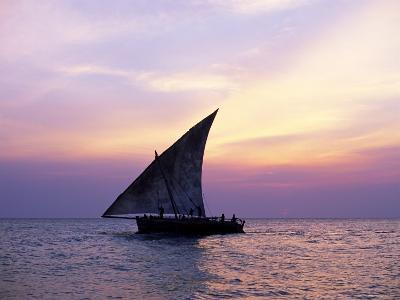 Dhow in Silhouette on the Indian Ocean at Sunset, off Stone Town, Zanzibar, Tanzania, East Africa