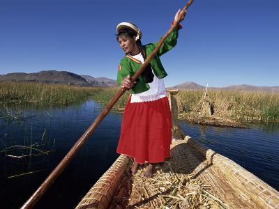 Portrait of a Uros Indian Woman on a Traditional Reed Boat, Lake Titicaca, Peru