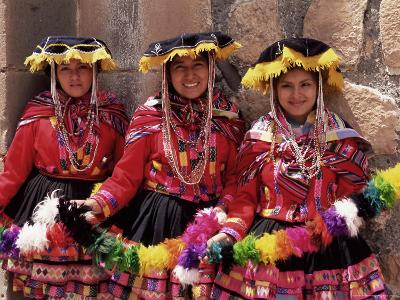 Portrait of Three Smiling Local Peruvian Girls in Traditional Dance Dress, Peru