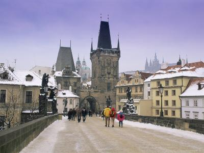 Charles Bridge and St. Vitus Cathedral in Winter Snow, Czech Republic