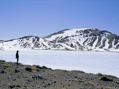 Hiker on Tongariro Crossing Trek by Blue Lake Under Winter Ice and Snow, North Island, New Zealand