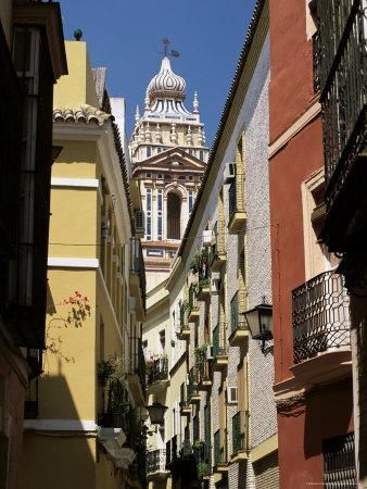 View Along Narrow Street to Ornately Decorated Church, Andalucia (Andalusia), Spain