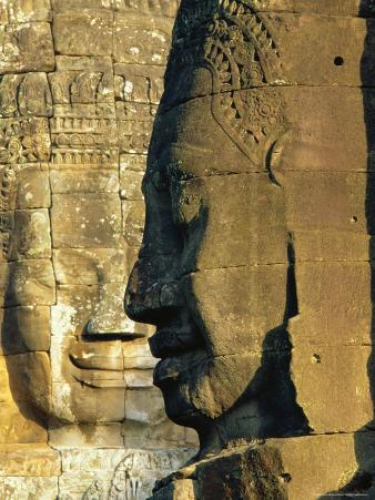 Stone Heads Typifying Cambodia on the Bayon Temple at Angkor Wat, Siem Reap, Cambodia, Asia.