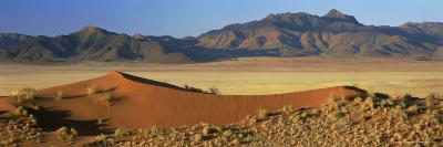 Panoramic View Over Orange Sand Dunes Towards Mountains, Namib Rand Private Game Reserve, Namibia