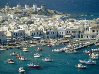 Aerial of the Harbour and Mykonos Town with Windmills in the Background, Greece