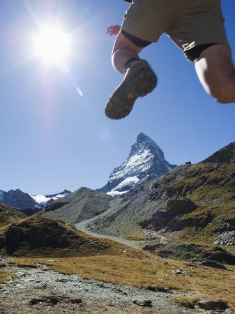 Hiker Running on Trail and the Matterhorn, 4477M, Zermatt Alpine Resort, Swiss Alps, Switzerland