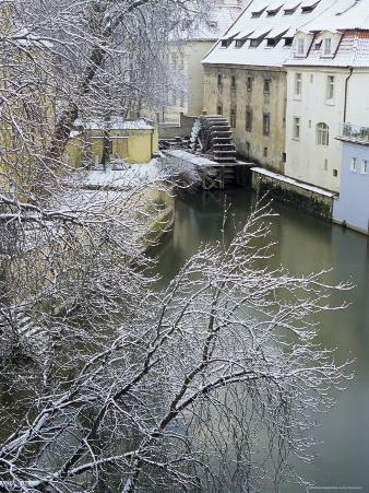 Snow-Covered Certovka Canal and Water Wheel at Kampa Island, Czech Republic, Europe