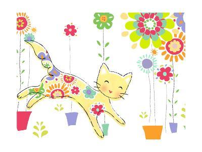 Miss Kitty Enjoys Flowers