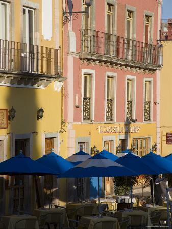 Balconies on Painted Houses Overlooking Tables with Umbrellas, Guanajuato, Mexico