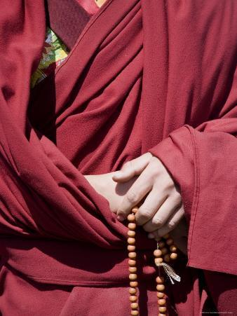 Close Up of a Buddhist Monk's Hands with Prayer Beads, Qinghai, China