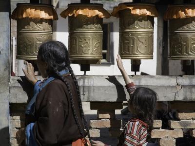 Buddhist Woman and Child Spin Brass Prayer Wheels, Qinghai, China