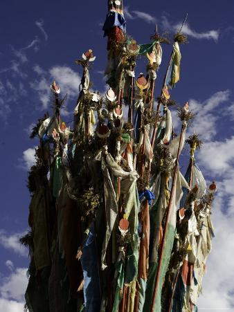 Cluster of Tibetan Prayer Flags against a Blue Sky with Clouds, Qinghai, China