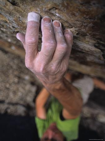 Hand Reaches Up for a Small Hold on a Rock Climb in Wyoming