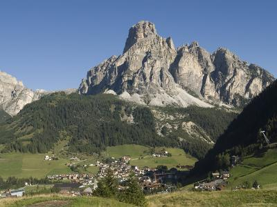 Italian Village Rimmed by Mountains in the Dolomites, Italy
