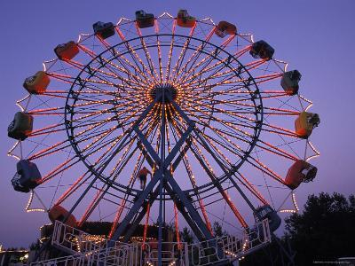 People Ride an Upsidedown Ferris Wheel in Wildwood, New Jersey