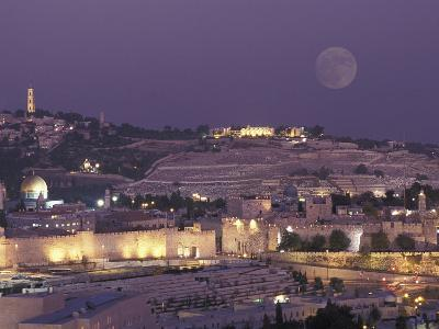 Moon over the Dome of the Rock and Mount Olives in Jerusalem, Israel